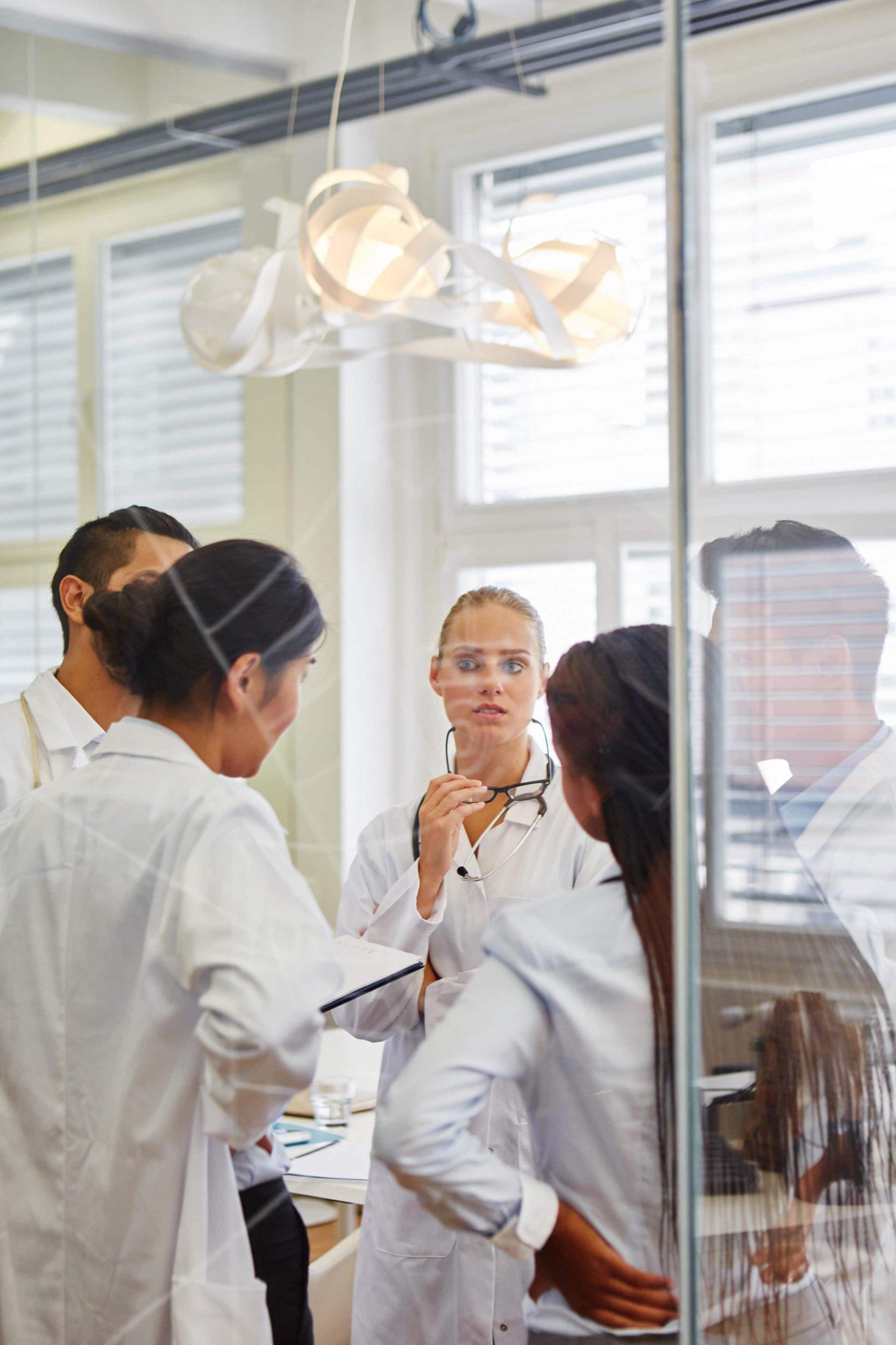 Doctors brainstorming during meeting as team in workshop